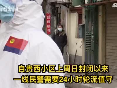 """驻守闭环管理小区,上海民警为战""""疫""""推迟婚礼"""